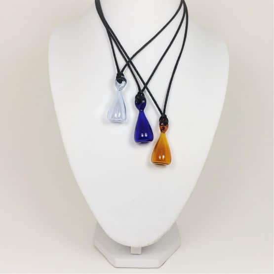 Three colours of Teardrop-shaped glass oil-diffusing pendant necklace on Bust that gently diffuses your essential oils.